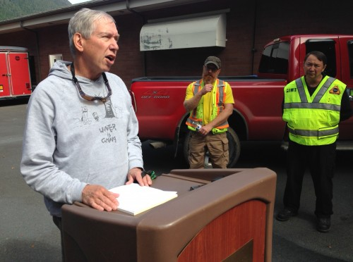 National Weather Service Meteorologist Joel Curtis (left) spoke with reporters Friday, along with DOT geologist Mitch McDonald and Deputy Fire Chief Al Stevens. (Photo by Robert Woolsey/KCAW)