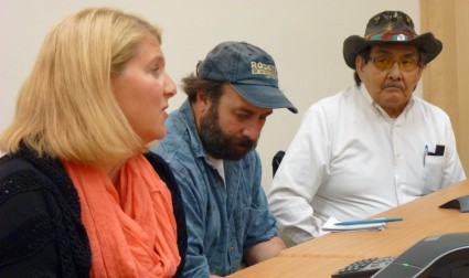 Salmon Beyond Borders' Heather Hardcastle reacts to the week's mining meetings while Rivers Without Borders' Chris Zimmer, center, and the Douglas Indian Association's John Morris listen. (Photo by Ed Schoenfeld/ CoastAlaska News)