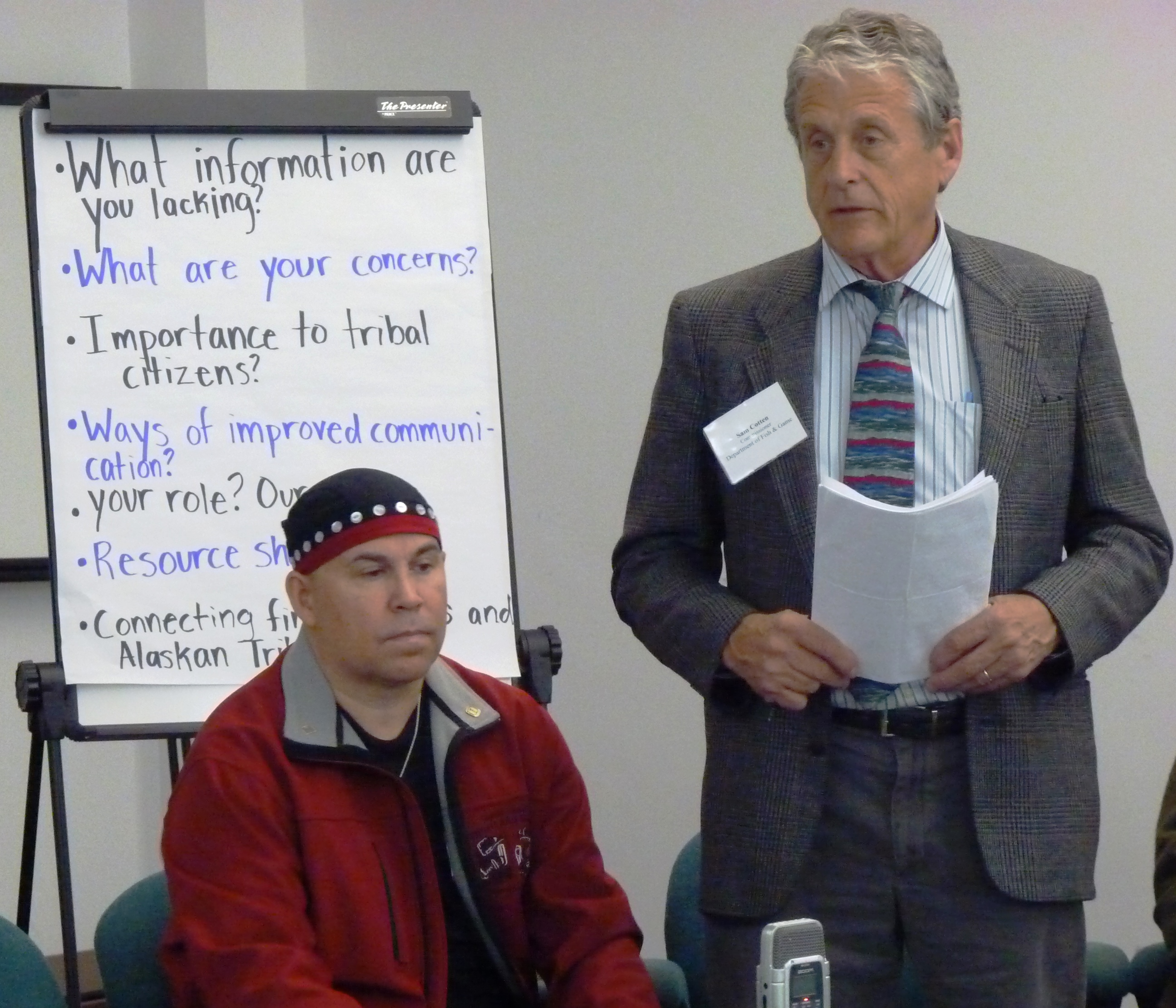 Fish and Game Department Commissioner Sam Cotten speaks while Rob Sanderson Jr. listens during a meeting with tribal leaders in Juneau. ES photos.