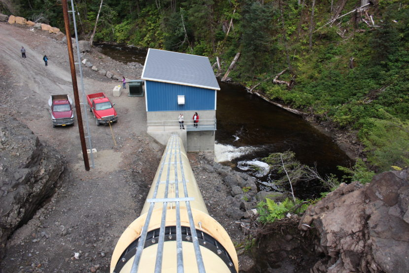 Water flows down the tube and spins a turbine that creates electricity. (Photo by Elizabeth Jenkins/KTOO)