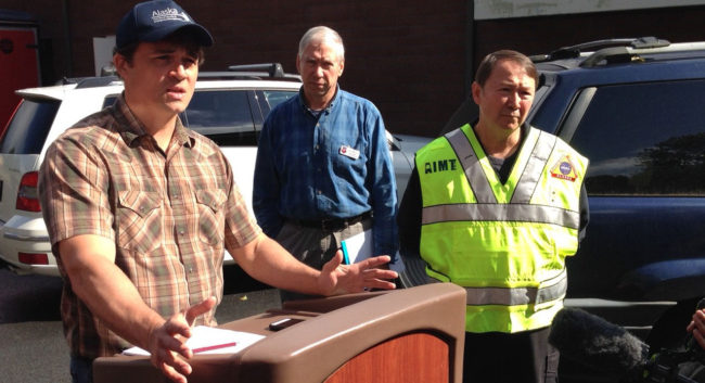 Jeremy Zidek, spokesman for Homeland Security, briefs the media Thursday morning in Sitka. National Weather Service incident meteorologist Joel Curtis (center), and incident commander Al Stevens (right), were preparing for more rain on Friday. (KCAW photo)