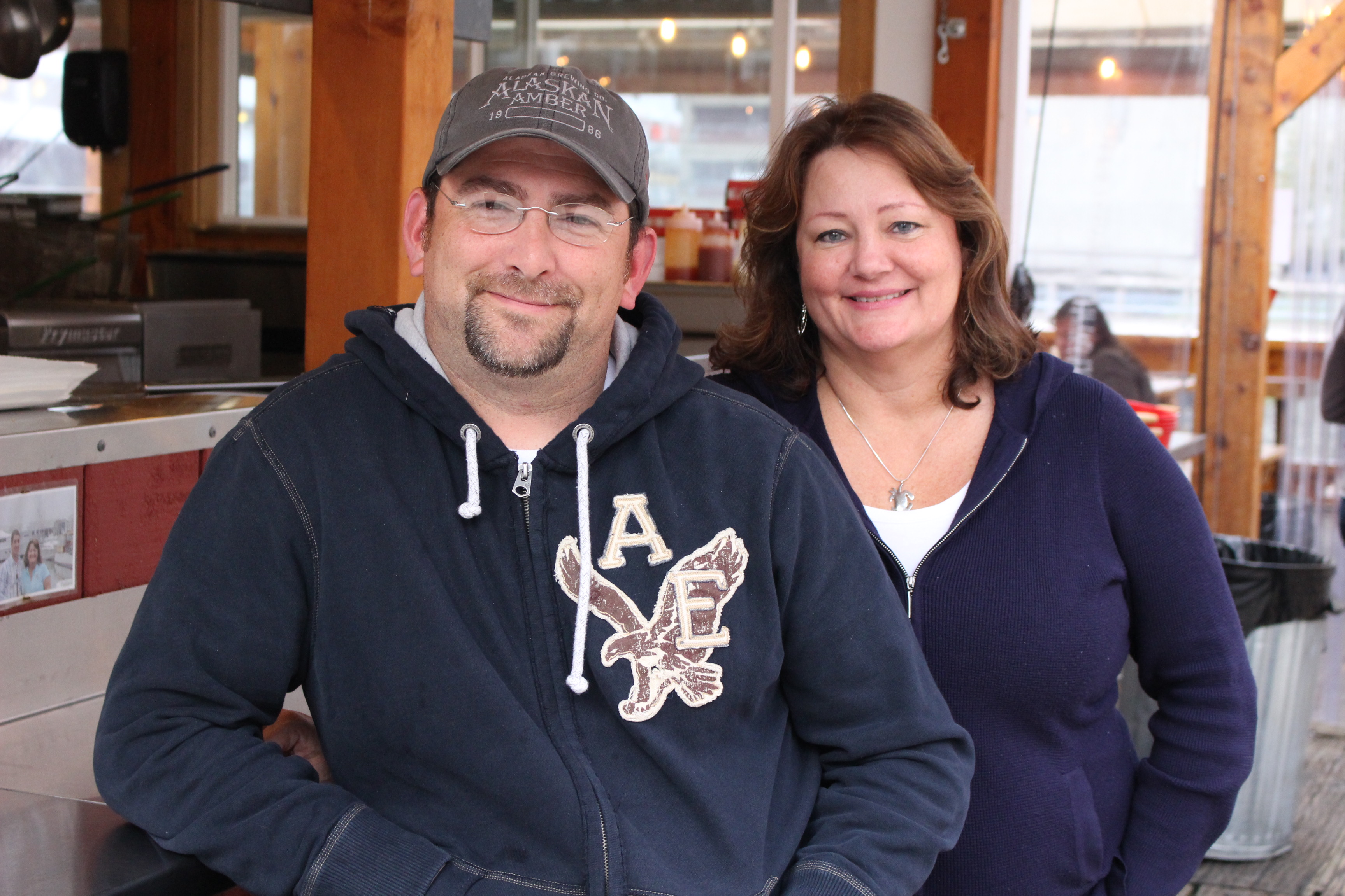 David McGivney and Tracy LaBarge sit outside their other establishment, Tracy's King Crab Shack. (Photo by Elizabeth Jenkins/KTOO)