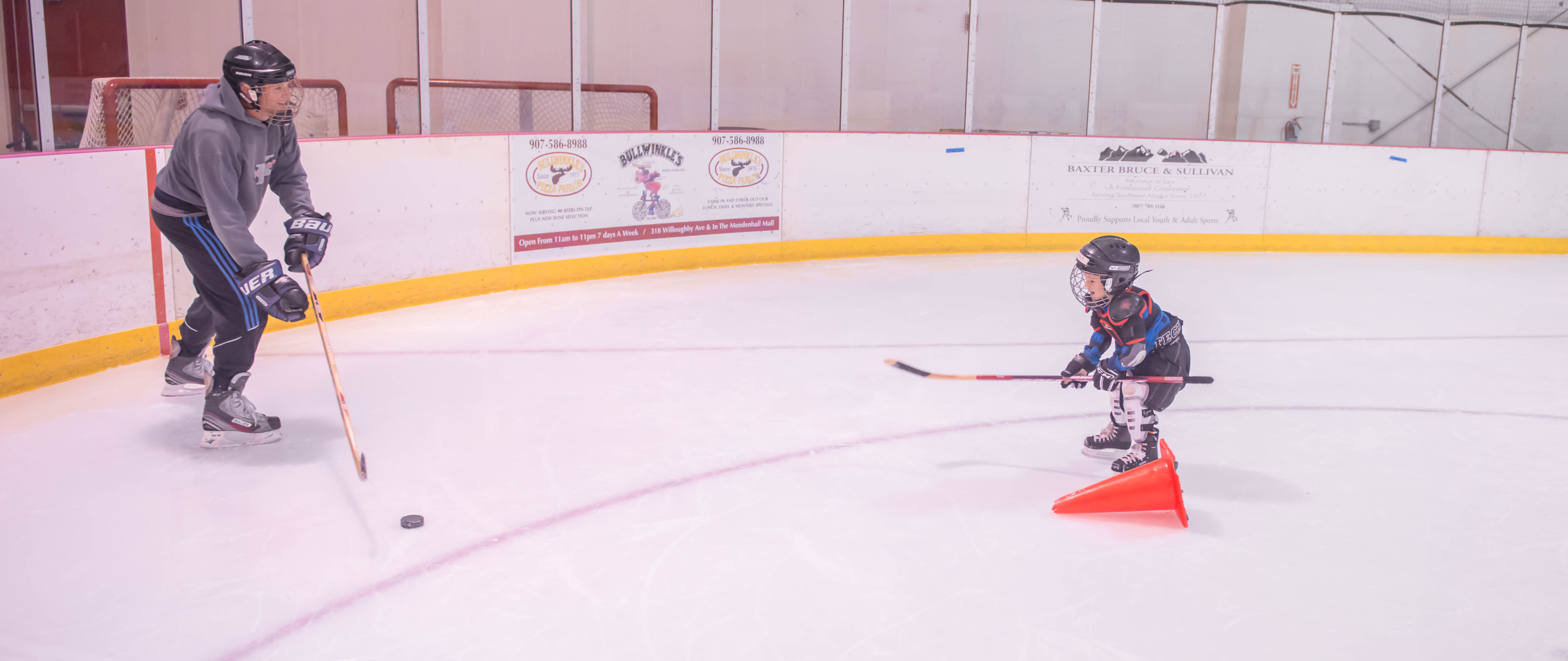 Randy Host (left) enjoys some ice time with his son Mack at JDIA's Learn to Play afternoon at Treadwell Ice Arena. (Photo by Steve Quinn)