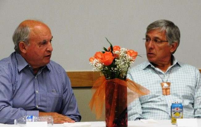 British Columbia Mines Minister Bill Bennett, left, and Alaska Lt. Gov. Byron Mallott talk at a dinner at Juneau's Walter Soboleff Center in August. (Photo courtesy governor's office)