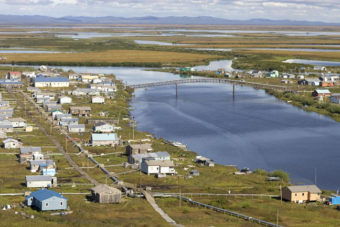 """The community of Selawik, near the mouth of the Selawik River, is home to over 800 people. The site of the village, spread between riverbanks and an island, is also called Akuligaq, meaning """"a river fork."""" (Photo by Steve Hillebrand/USFWS)"""