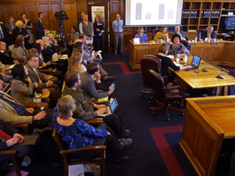 Diane Kaplan, president and CEO, Rasmuson Foundation (at table facing camera) presents the results of a public survey to the House Finance Committee, January 20, 2016. The Rasmuson survey asked Alaskans what they think about the state's fiscal crisis. (Photo by Skip Gray/360 North.)