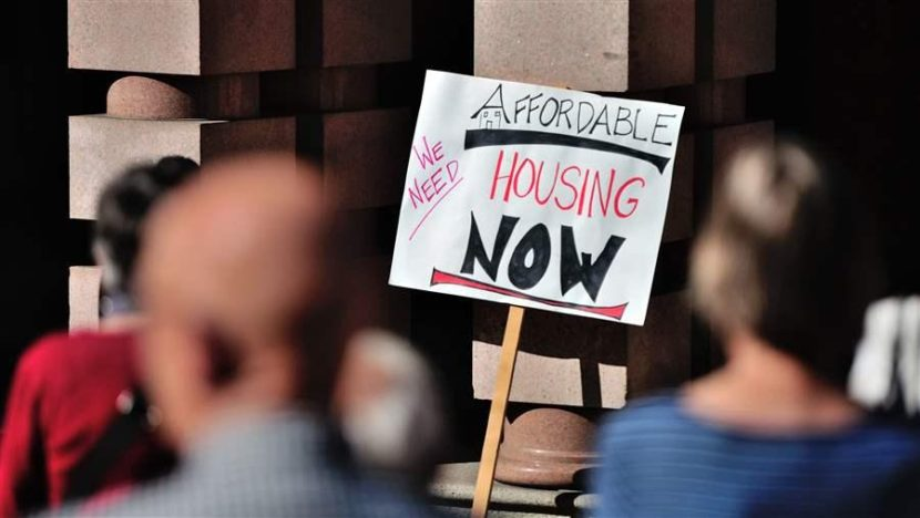 A group rallies for affordable housing outside City Hall in Portland, Oregon. States and cities are looking for ways to ease the housing crunch. AP