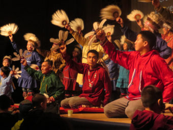 Byron Nicholai (center) and the Toksook Bay Traditional Dancers perform at the 2016 Cama-i Dance Festival in Bethel. (Photo by Laura Kraegel/KNOM)