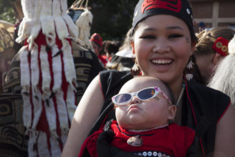 Nakiya Lundy, 19, and her daughter Luna Lundy, 8 months, wait for their spot in a processional and grand entrance on Wednesday, June 8, 2016, in Juneau, Alaska. (Photo by Rashah McChesney/KTOO)