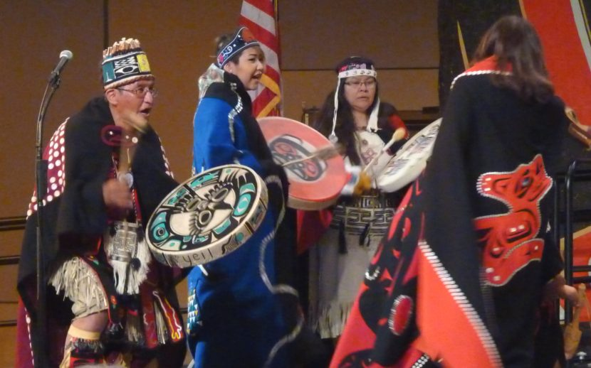 Taku Kwaan Dance Leader Wayne Carlick and others drum as more than 30 people take the stage during Celebration 2016 (Photo by Ed Schoenfeld/CoastAlaska News)