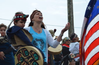 Hundreds of people lined the shores of Douglas Harbor, June 8, 2016 to welcome the canoes. (Photo by Jennifer Canfield/KTOO)
