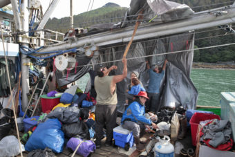 Members of the One People Canoe Society prepare their safety boat before hopping into canoes to finish paddling from Angoon to Juneau on Wednesday, June 8, 2016, near Juneau, Alaska. The society began the trip on June 2. Their landing on Douglas Island is the unofficial beginning of Celebration. (Photo by Rashah McChesney/KTOO)