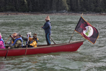 Members of the One People Canoe Society work during the last leg of their trip from Angoon to Juneau on Wednesday, June 8, 2016, near Juneau, Alaska. The society began the trip on June 2. Their landing on Douglas Island is the unofficial beginning of Celebration. (Photo by Rashah McChesney/KTOO)