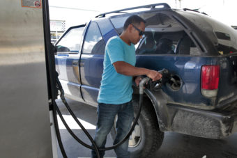 Richard Carrillo, of Juneau, gases up his suburban on July 7, 2016, in Juneau, Alaska. State economists said low energy prices caused a slower growth of inflation in Alaska last year. (Photo by Rashah McChesney/KTOO)