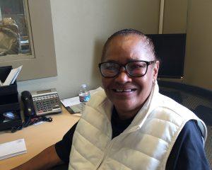 Ivory Mack at her desk at Bean's Cafe. (Hillman/KSKA)