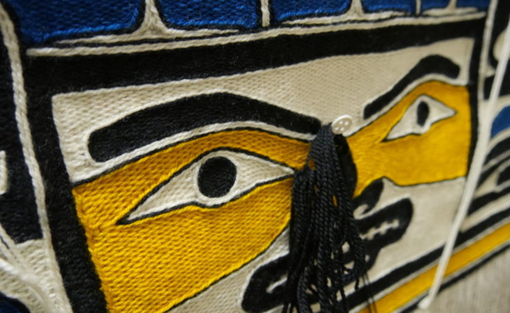 One of the details of the Weavers Across Waters Chilkat/Ravenstail community robe. Della Cheney and Clarissa Rizal worked Monday afternoon, August 22, 2016, on braiding the side borders for the robe at the Sealaska Heritage Institute, Juneau. (Photo by Tripp J Crouse/KTOO)