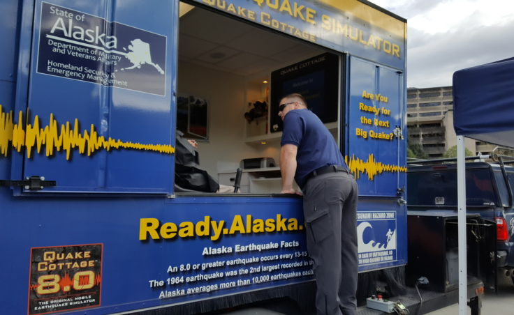 Chad Fullmer gives instructions to participants preparing to ride in Alaska's earthquake simulator on Wednesday, August 31, 2016. Fullmer is an emergency management specialist with the Alaska Division of Homeland Security and Emergency Management. (Photo by Tripp J Crouse/KTOO)