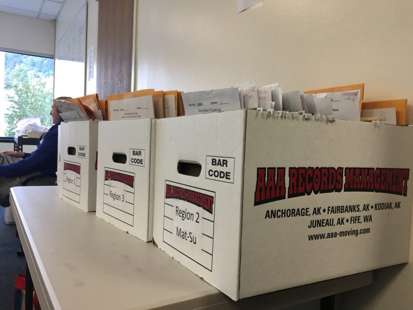 Election review board members work to certify the primary results at the Alaska Division of Elections office in Juneau, Aug. 30, 2016. (By Andrew Kitchenman/KTOO)