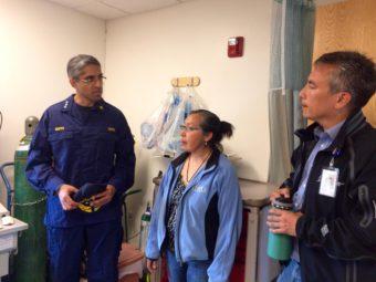 U.S. Surgeon General Dr. Vivek Murthy in the Napaskiak clinic with Community Health Practitioner Augusta Williams and YKHC CEO Dan Winkelman. (Anna Rose MacArthur, KYUK)