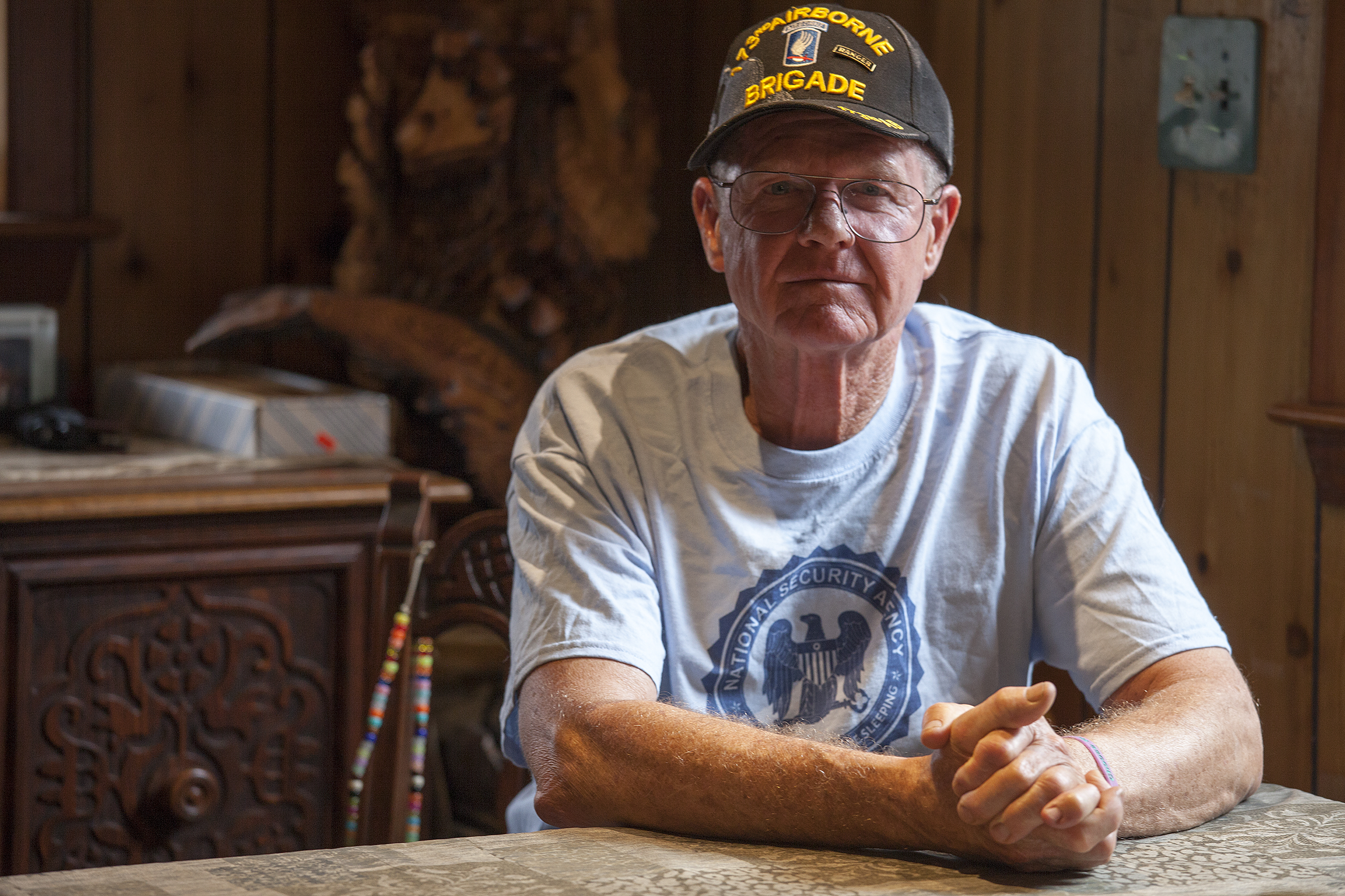 John Suter sits in his dining room in Chugiak. His appeal with the Ombudsman's Office has been ongoing for more than a decade. (Photo by Rashah McChesney/ KTOO)