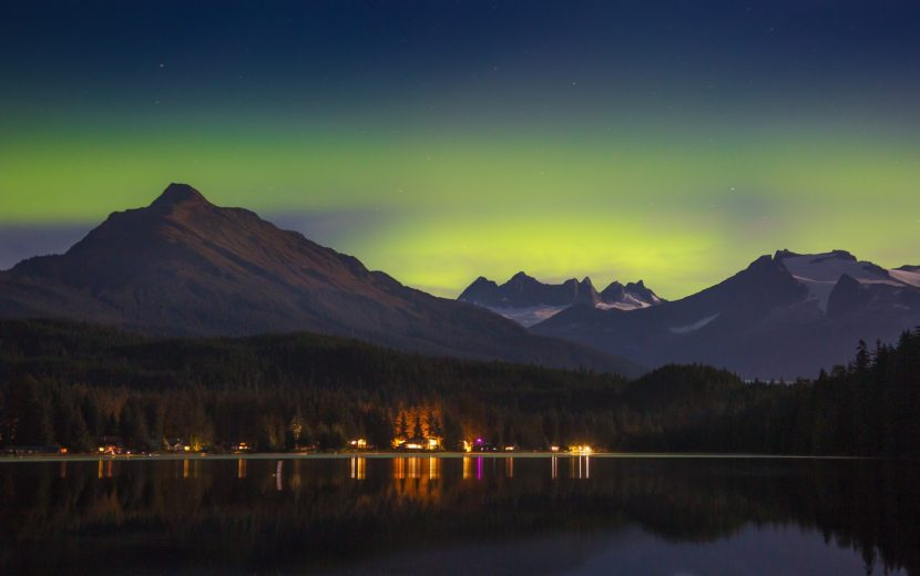 The aurora casts an eerie green light behind the mountains over Juneau on late Wednesday. (Photo by Matt Knutson)