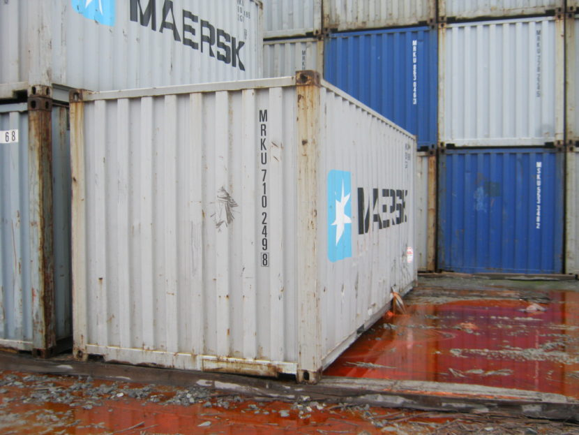 Fish oil pours out of a punctured shipping container. (David Toonan/U.S. Coast Guard)