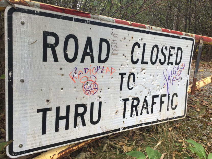 A sign at the end of Glacier Highway, near where the Juneau Access Road extension would be built. Gov. Walker is weighing whether to back the project.Oct. 4, 2016. (Photo by Andrew Kitchenman/KTOO)