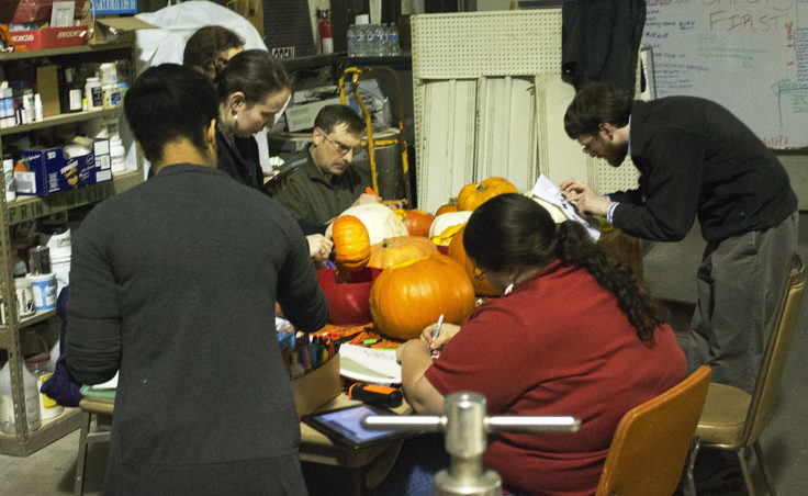 Juneau Makerspace members and participants carve pumpkins on Monday, October 24, 2016. The group hosts open studio nights every Monday night, except on holidays. (Photo by Tripp J Crouse/KTOO)