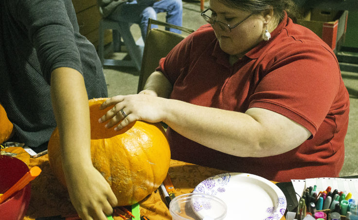 Grace Amundsen traces a patter on to her pumpkin during Juneau Makerspace's open studio night on Monday, Oct. 24, 2016. The weekly open studio nights are free and open to the public. (Photo by Tripp J Crouse/KTOO)