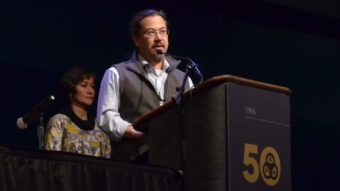 Joe Nelson withdrew his candidacy for co-chair of the Alaska Federation of Natives board at the 2016 convention. Behind him is co-chair Ana Hoffman. (Photo by Jennifer Canfield)