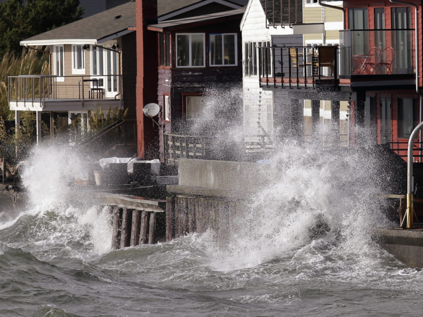 Waves batter a seawall on Friday in Seattle. The remnants of a typhoon brought rain and wind to the Pacific Northwest on Friday and Saturday. Elaine Thompson/AP