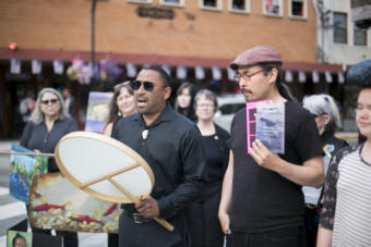 Juneau Arts and Humanities Council Education Director Stephen Qacung Blanchett of the band Pamyua shares a prayer song next to Ishmael Hope at the peaceful demonstration protesting budget cuts to the Alaska State Council on the Arts. Photo by Annie Bartholomew)