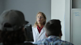 Professor Shannon Atkinson introduces her new class to DEMBONES, Thursday.
