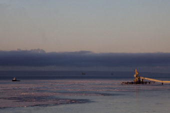 Cook Inlet oil platforms are visible from shore on Dec. 13, 2016 near Kenai, Alaska.