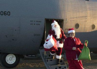 Santa Claus and Mrs. Claus deliver gifts to Togiak in 2016 as part of Alaska's 60th Operation Santa Claus. (Photo by Alaska Army National Guard)