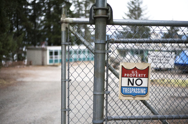 A chain-link fence cordons off the entrance to the Auke Bay Marine Station on Tuesday, Jan. 31, 2017. Juneau Docks and Harbors is interested in the NOAA property for potential expansion of Statter Harbor. (Photo Tripp J Crouse/KTOO)