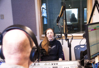 KTOO's Matt Miller talks to Erin Heist of Juneau on Friday, Feb. 3, 2017, about an old rumor that she'd heard of a gorilla running for mayor. She didn't know it at the time, but the rumors were true. Or mostly true. (Photo by Tripp J Crouse/KTOO)