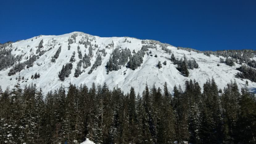 An avalanche down this ridge outside the Eaglecrest Ski Area boundary facing the parking lot caught one skier on Saturday, March 4, 2017. The skier was injured. (Photo courtesy Mikko Wilson)
