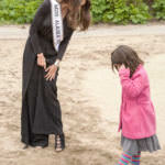 Miss Alaska USA Alyssa London compares shoes with a Juneau Community Charter School student Thursday, May 25, 2017, on Sandy Beach. (Photo by Tripp J Crouse/KTOO)