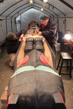 Herb Sheakley, left, and Mick Beasley right work on the healing Raven totem.