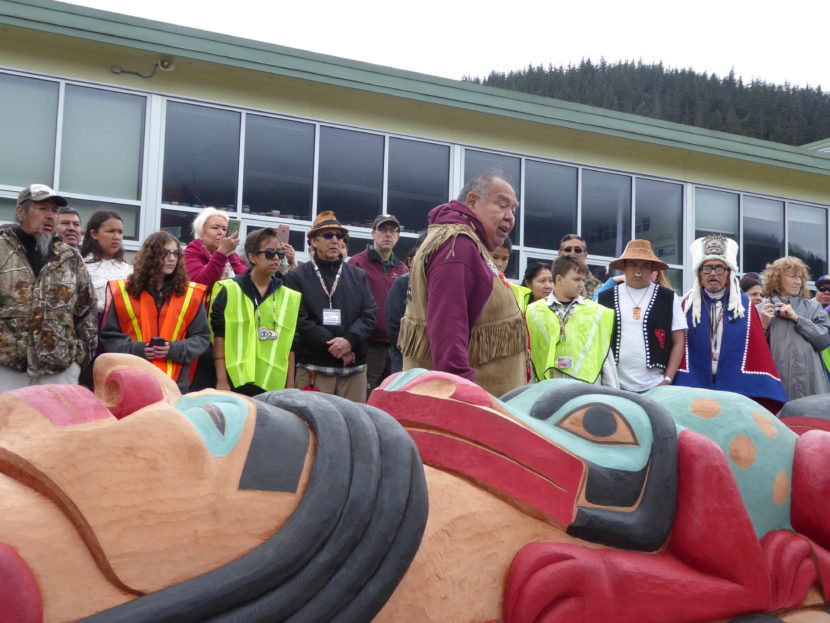 David Katzeek explains the significance of one of the faces on the totem pole at Saturday's ceremony.