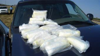 An Oklahoma narcotics agent displays 20 pounds of Mexican crystal meth seized from a drug dealer. As federal, state and local health officials focus on the opioid epidemic, the supply and use of methamphetamine is surging in Oklahoma and other Western, Midwestern and Southern states. (Photo courtesy Oklahoma Bureau of Narcotics)
