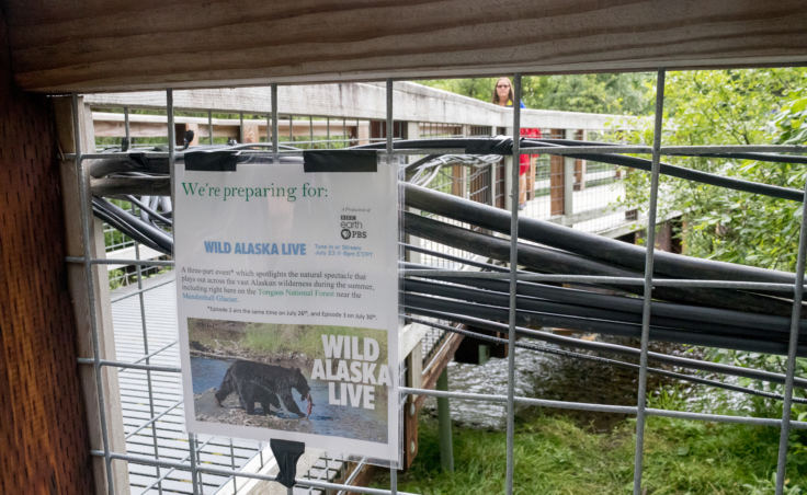 A sign informs visitors of the upcoming Wild Alaska Live broadcast as cables are hung from walkways. (Photo by Mikko Wilson/KTOO)