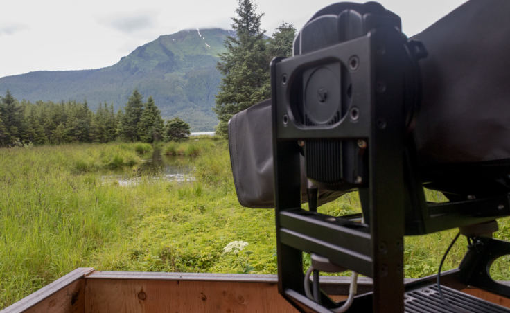 A robotic camera provides for wildlife tracking across a meadow near the Mendenhall Glacier Visitors Center for Wild Alaska Live. (Photo by Mikko Wilson/KTOO)