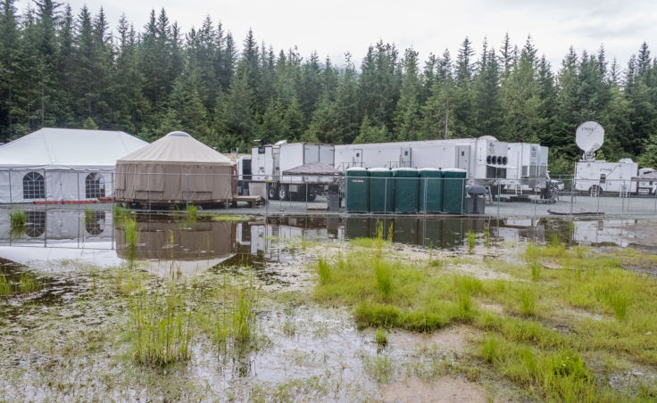 The Wild Alaska Live production village at the back of the Mendenhall Glacier Visitor Center bus parking lot. (Photo by Mikko Wilson/KTOO)