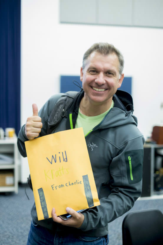 Chris Kratt holds an envelope of gifts from Charlie and Anna Begenyi backstage after Meet The Kratts, Wild Alaska Live Meet & Greet at Thunder Mountain Auditorium. (Photo by Annie Bartholomew/KTOO