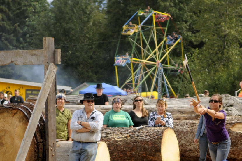 A woman competes in the axe throwing contest during the logging show at the 2016 Southeast Alaska State Fair. (Photo by Jillian Rogers/KHNS)