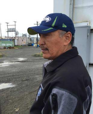 Warren Jones, the CEO of Qanirtuuq Inc., surveys Quinhagak's defunct processing plant. (Photo by Teresa Cotsirilos/KYUK)