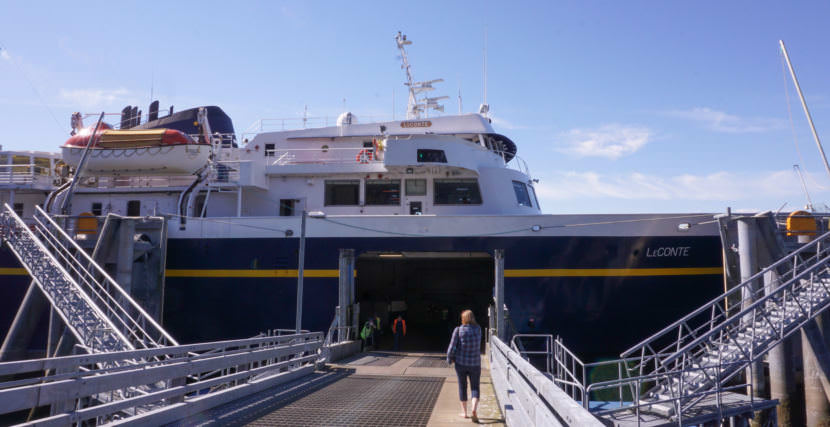 A passenger boards the Alaska Marine Highway System ferry LeConte in Pelican on Aug. 6, 2017.