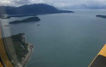 An Alaska Seaplanes aircraft makes its way to Juneau in June 2017.
